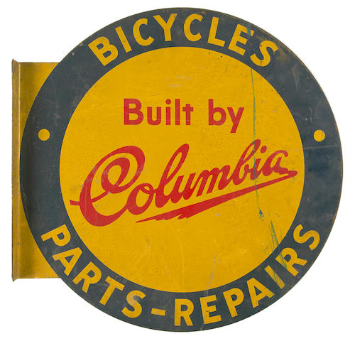 A Columbia Bicycles sign,