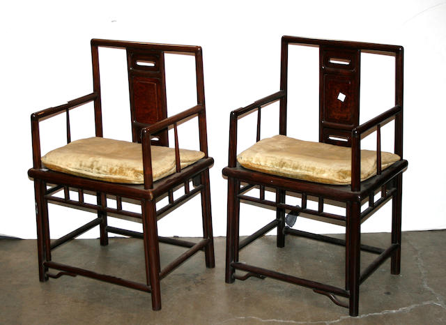 A pair of paneled arm chairs