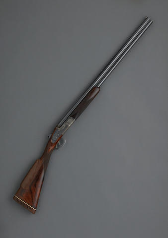 A rare 20 gauge English over/under sidelock ejector gun by James Woodward