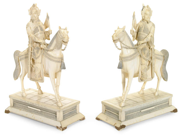A pair of Chinese carved ivory equestrian warriors or generals