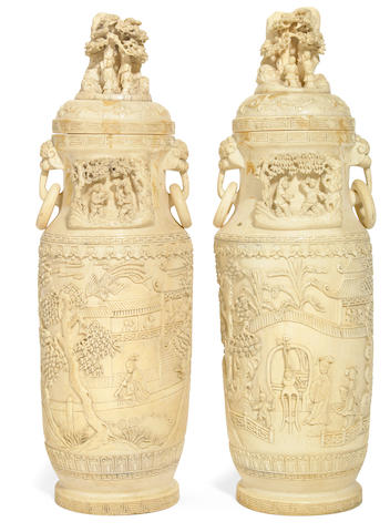 A pair of Chinese carved ivory temple vases and covers