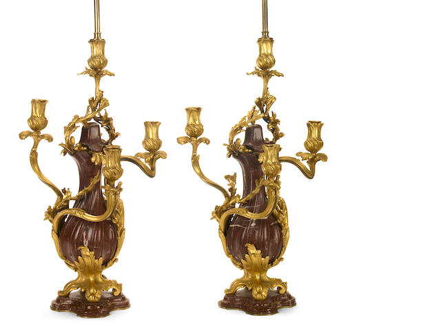 A pair of Louis XV style gilt bronze and rouge marble five light candelabra as table lamps <br>E. Colin & Cie Paris foundry<br>late 19th century