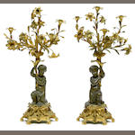 A pair of Napoleon III gilt and patinated bronze five light candelabra <br>third quarter 19th century