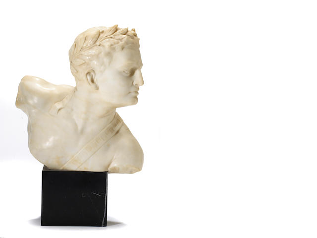 An Italian carved alabaster bust of an athlete