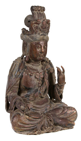 A Chinese hardwood seated figure