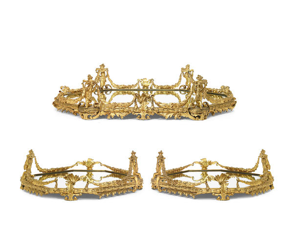A suite of three French gilt bronze surtout de table  late 19th century