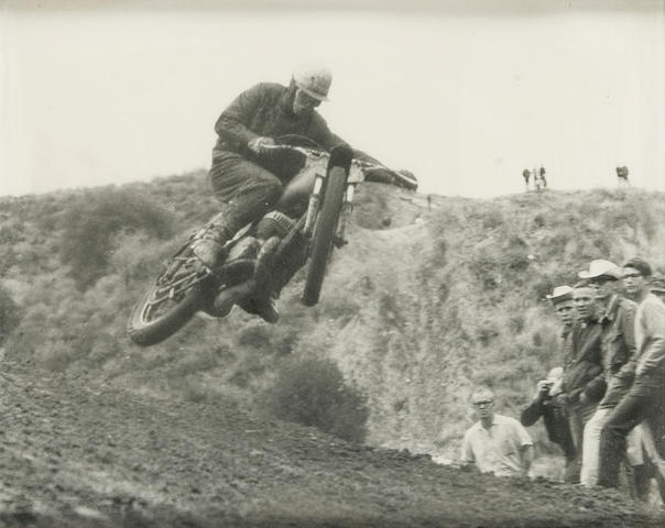 A photograph of Bud Ekins jumping a motorcycle during an off-road race,