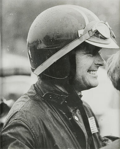 A photograph of Bud Ekins in ISDT jacket and helmet,