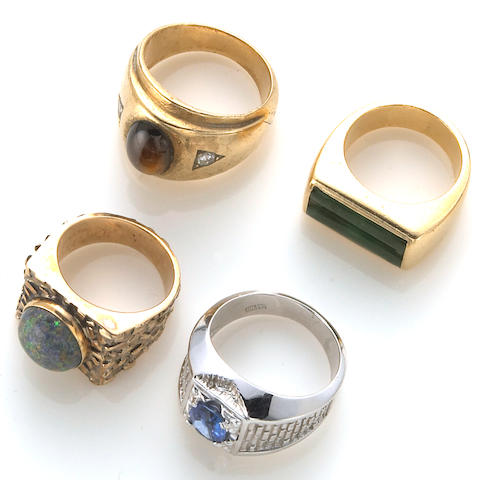 A collection of four diamond, opal, sapphire, brown star sapphire, jade and 14k gold gent's rings