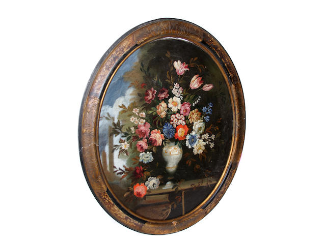 A pair of Continental School oval still life paintings of flowers