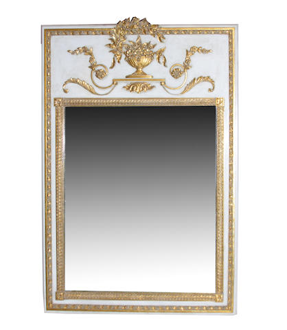 A Louis XVI style parcel gilt and grey painted trumeau mirror