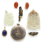 A collection of jewelry, including five pendants, a pair of earrings and a brooch