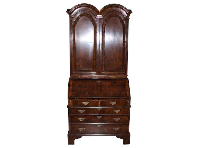 A George I style walnut secretary bookcase