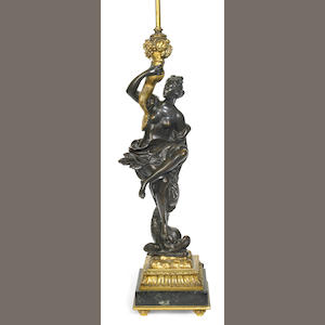 A French patinated and gilt bronze figural table lamp