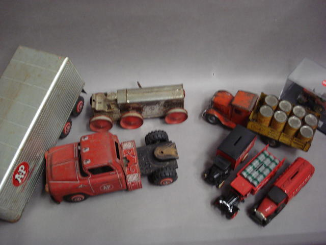 A selection of tinplate and scale model trucks,