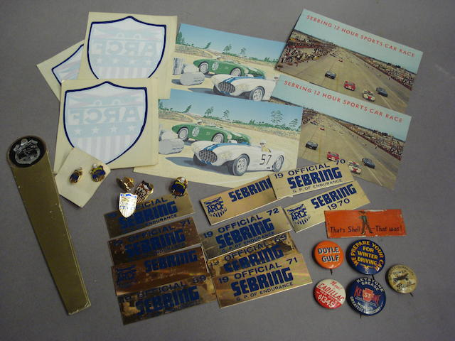 A good selection of motoring badges, lapel pins and Sebring plaques,