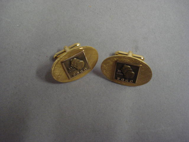 A pair of 10 karat gold commemorative Ford cufflinks,