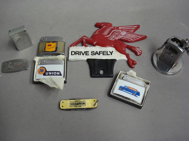A selection of motor oil lighters and collectables,