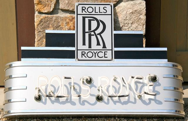 A Rolls-Royce neon sign,