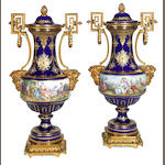 A pair of gilt bronze mounted Sèvres style 'jeweled' porcelain covered vases <br>late 19th century