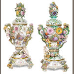 A pair of large Meissen flower-encrusted pot-pourri vases, covers and two stands