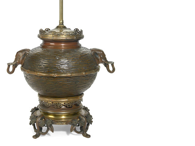 A French chinoiserie gilt and patinated bronze table lamp