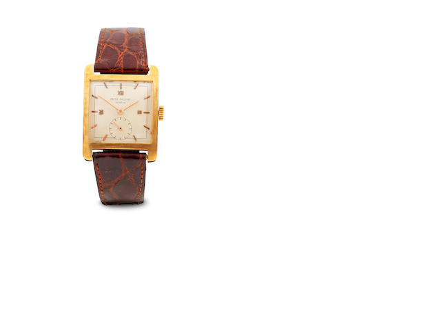 A Patek Philippe rectangular face wristwatch with leather strap, Ref 2433, mvt 958485, case 669449, 18J