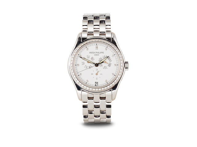 Patek Philippe. A fine 18K white gold and diamond automatic two time zone bracelet watch with center seconds and annual calendarRef 5035, movement no. 3136254