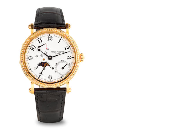 w/w 18k gold, Patek Philippe, model 5015, automatic, with moon-phases and power reserve indicator, gold buckle, movement #3050062, 240/154