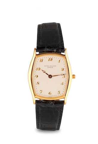 w/w 18k gold, Patek Philippe, Tonneau, automatic, silver dial, model #3942, movement #2821984, C 1985