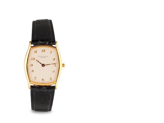 w/w 18k gold, Patek Philippe, Tonneau, automatic, silver dial, model #3942, movement #2821984, C 1985