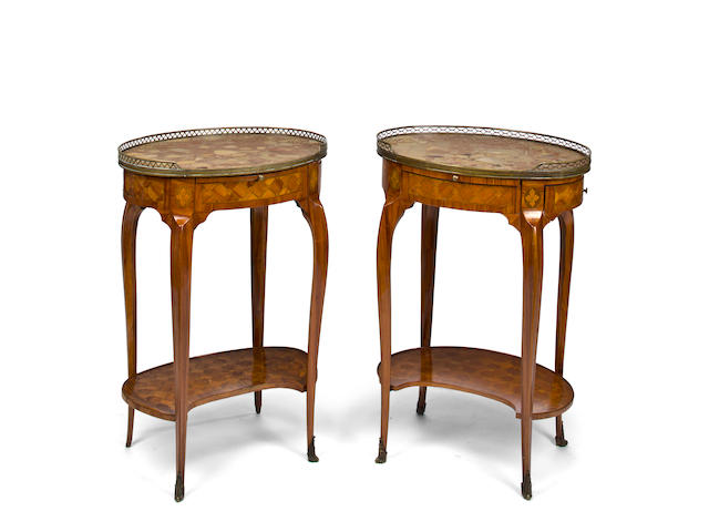 A pair of Louis XV/XVI Transitional style tulipwood parquetry tables à écrire<br>19th/20th century