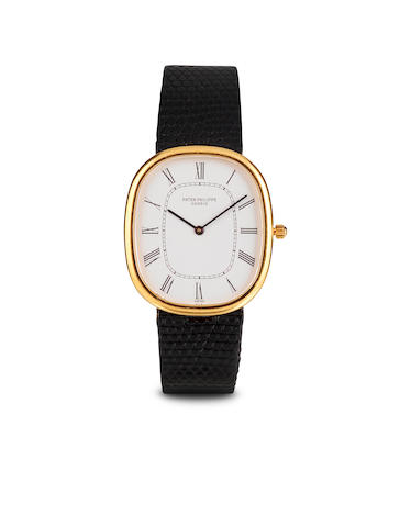 Patek Philippe. A fine 18K gold oval automatic wristwatchRef. 3738/100, case no. 2829139, 1980's