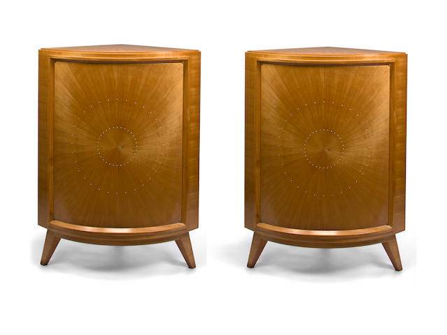 A pair of René Drouet ivory inlaid corner cabinets