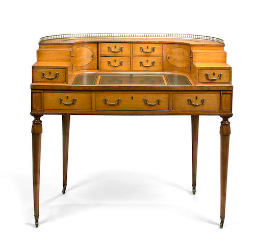 A fine George III gilt metal mounted satinwood Carlton House desk circa 1800