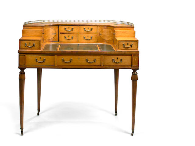 A Carlton House desk, minor damage on legs and sides