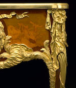 An impressive Louis XV style gilt-bronze mounted marquetry inlaid and bisque porcelain inset bureau plat  Maison Krieger after the bureau du roi by J. -F. Oeben and J. -H. Riesener circa 1900