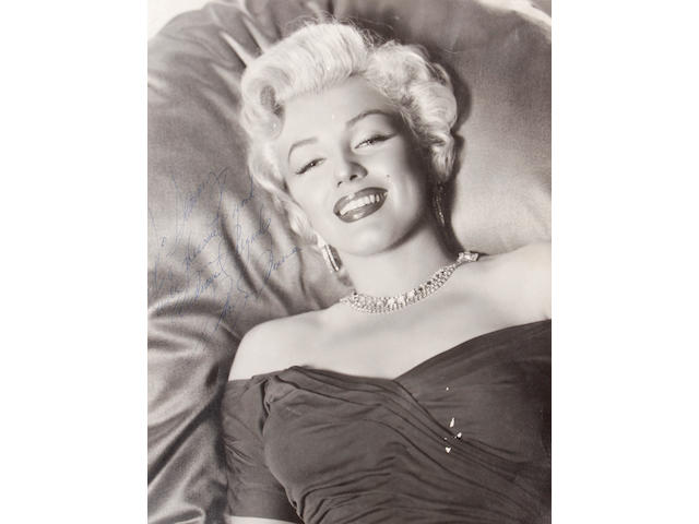 A Marilyn Monroe signed black and white photograph, early 1950s
