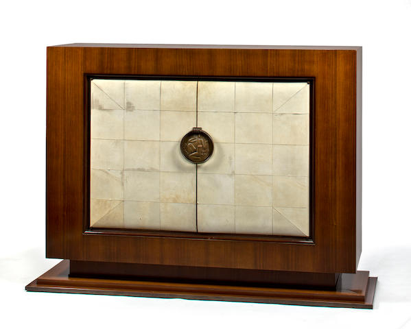 A Jean Pascaud mahogany and parchment covered cabinet