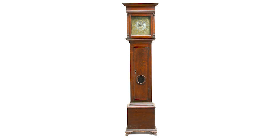 A Queen Anne walnut tall case clock, the brass works inscribed Peter Stretch, Philadelphia, 2nd quarter 18th century