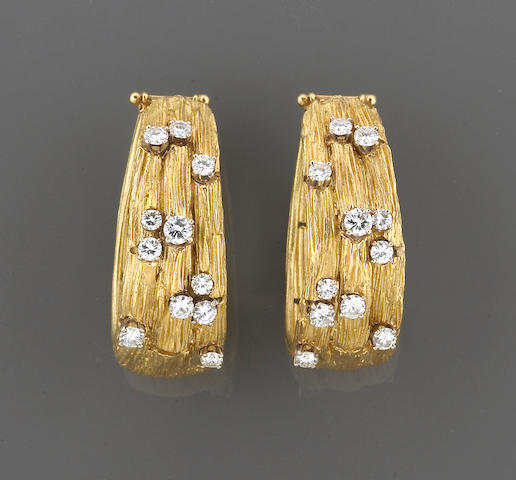 A pair of diamond hoop earclips