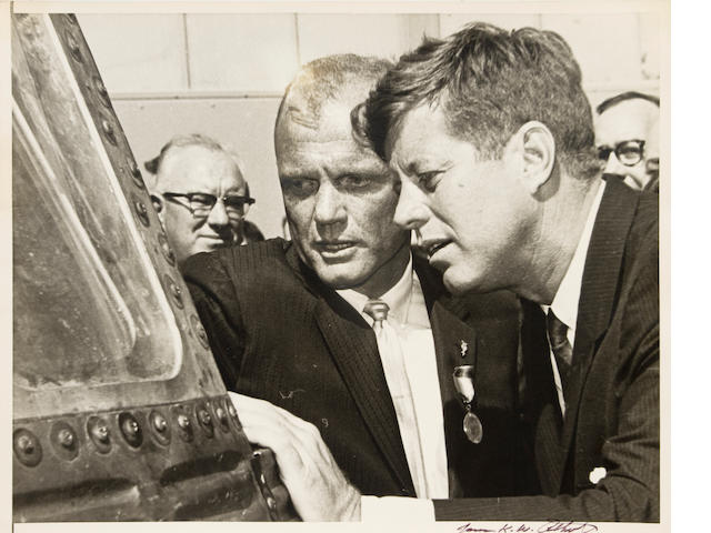 KENNEDY WITH ASTRONAUT JOHN GLENN.