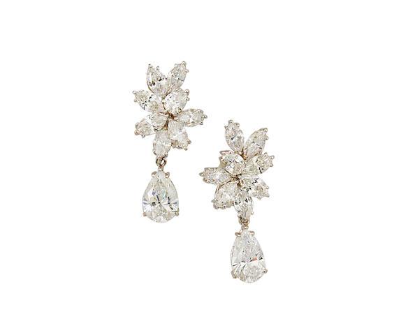 A pair diamond pendant day/night earrings