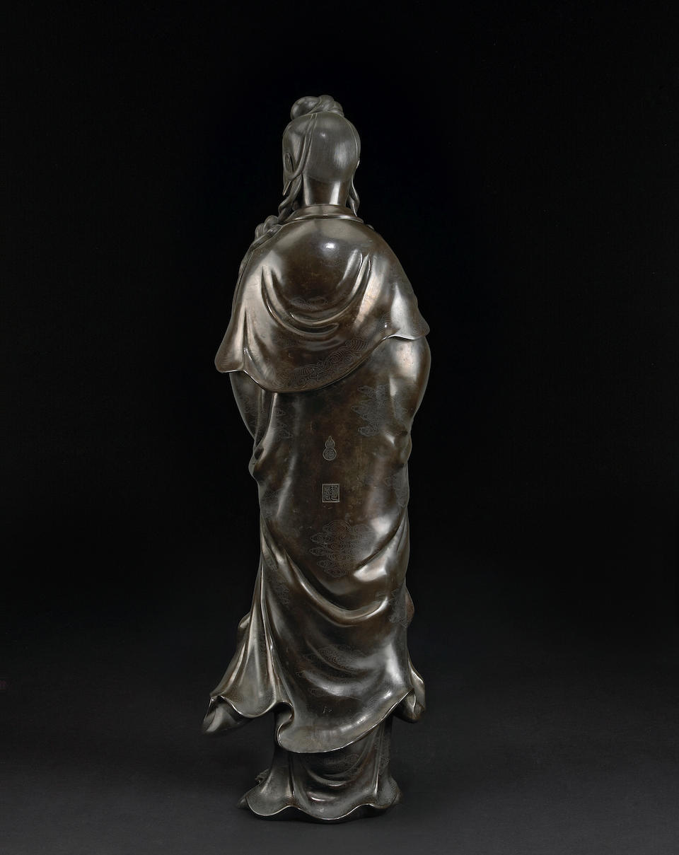 A monumental bronze Guanyin with silver wire inlay Qing Dynasty
