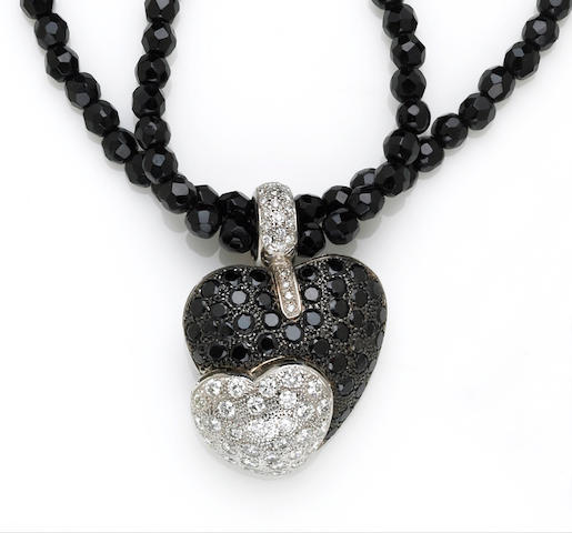 A diamond and black onyx heart motif pendant-enhancer