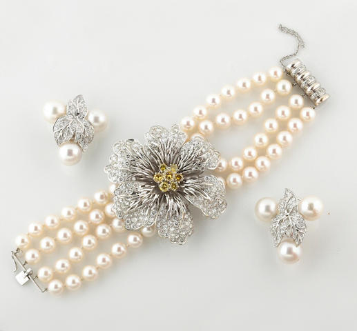 A diamond, colored diamond and cultured pearl bracelet and pair of earrings, Hammerman Bros.