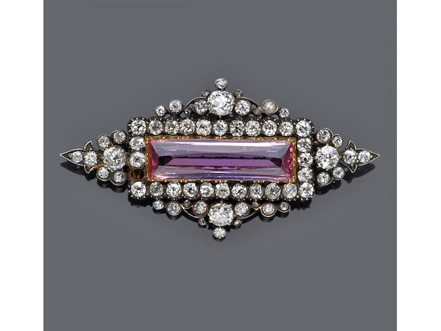 An antique pink topaz and diamond brooch,