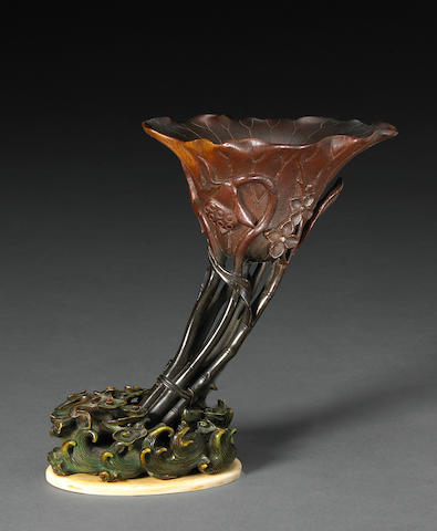 A fine and tall rhinoceros horn libation cup  17th/18th Century