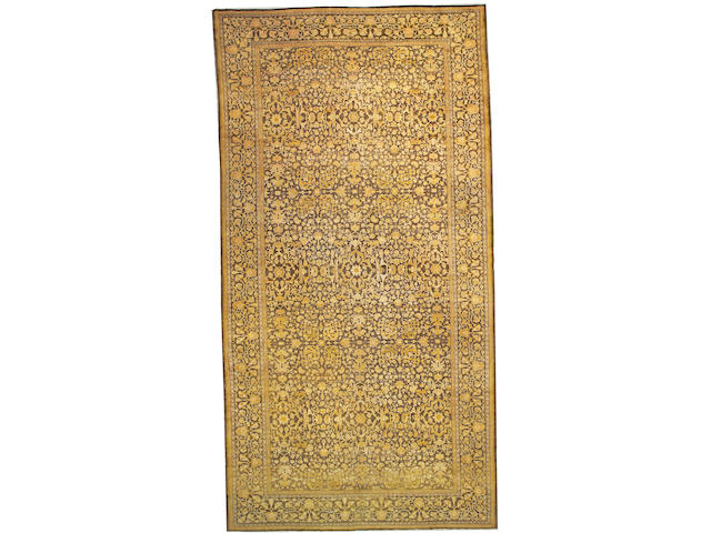 An Indo-Tabriz carpet India, size approximately 9ft. 2in. x 18ft. 2in.
