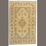 A Tabriz carpet Northwest Persia, size approximately 5ft. 5in. x 8ft. 10in.